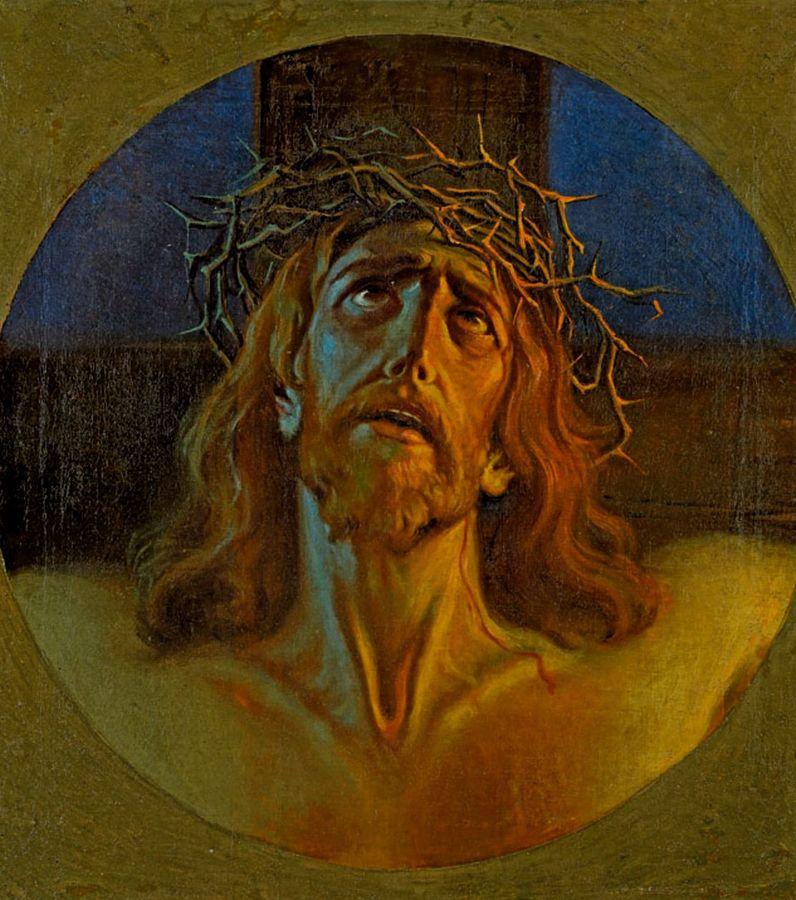 Obraz przedstawiający głowę Chrystusa w koronie cierniowej. Chrystus patrzy ku górze, ma lekko rozwarte usta, w tle widać fragment krzyża.